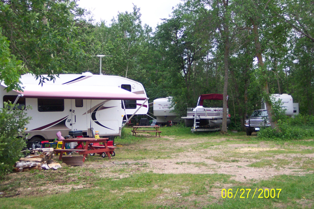 RV sites are all treed for privacy yet close enough for you to visit each other: Close to the docks and boat launch too