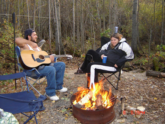 Relaxing at the bonfire in one of the RV sites at Harris Hill Resort on Lake of the Woods.: RV Sites and Camp Sites all have firepits supplied.