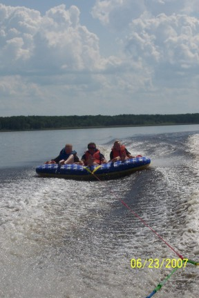 Tubing on a beautiful day at Harris Hill Resort - Lake of the Woods: Warm weather, sunshine, and families that like to enjoy life and fun together.