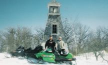 Snowmobiling and sight seeing is a great way to spend a winter's day: You can visit 2 lighthouses by snowmobile.